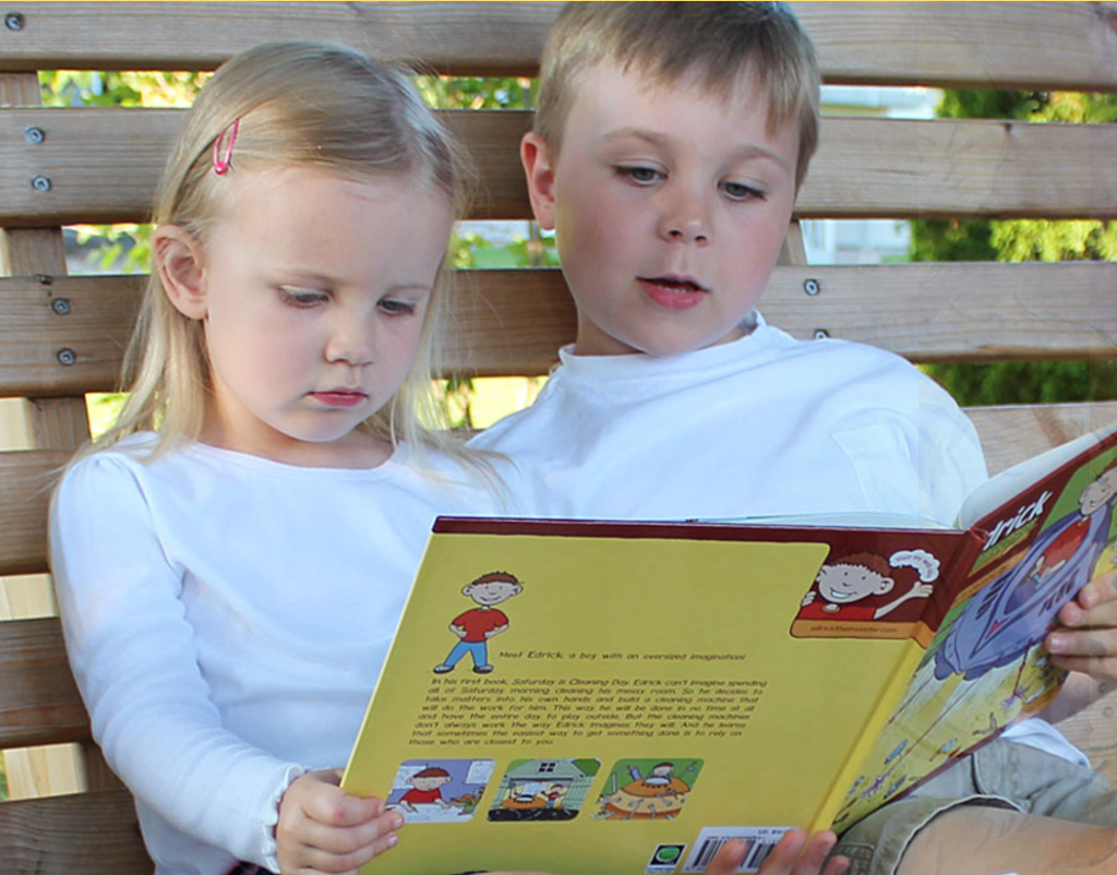 Children reading one of Craig Kunce' books