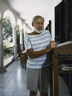 Loomis Dean Ernest Hemingway at the Standing Desk on the Balcony of Bill Daviss Home Near Malaga
