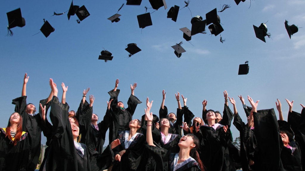 Cybersecurity - Photo of graduates throwing caps in the air