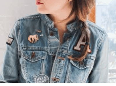 model wearing enamel pins